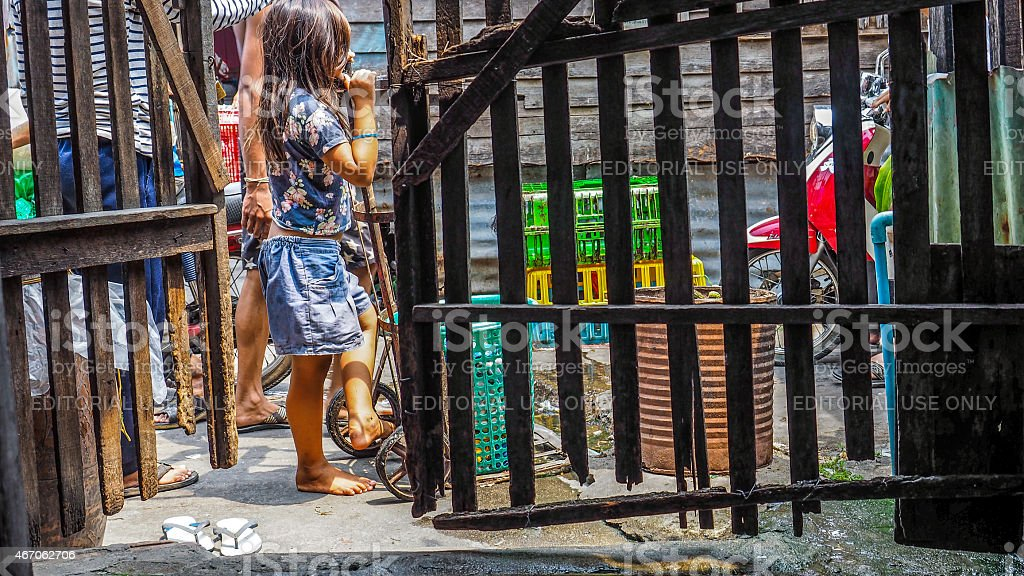 Thai child in a poor neighborhood stock photo
