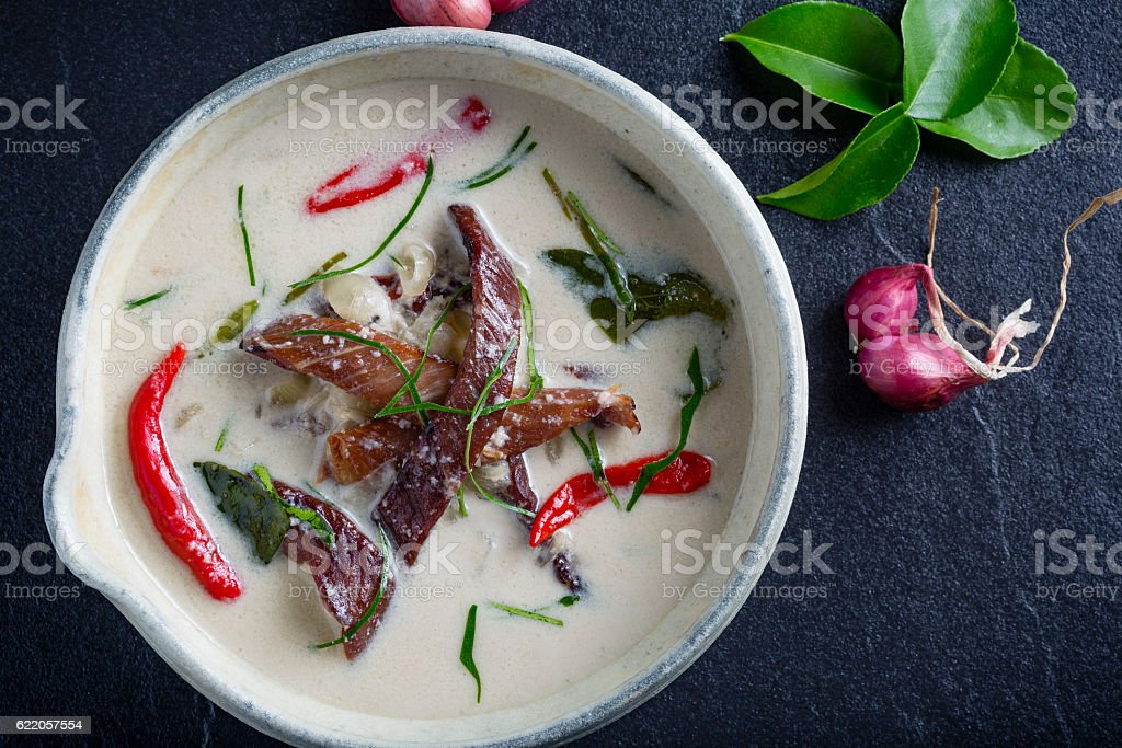 Thai coconut curry soup with beef stock photo