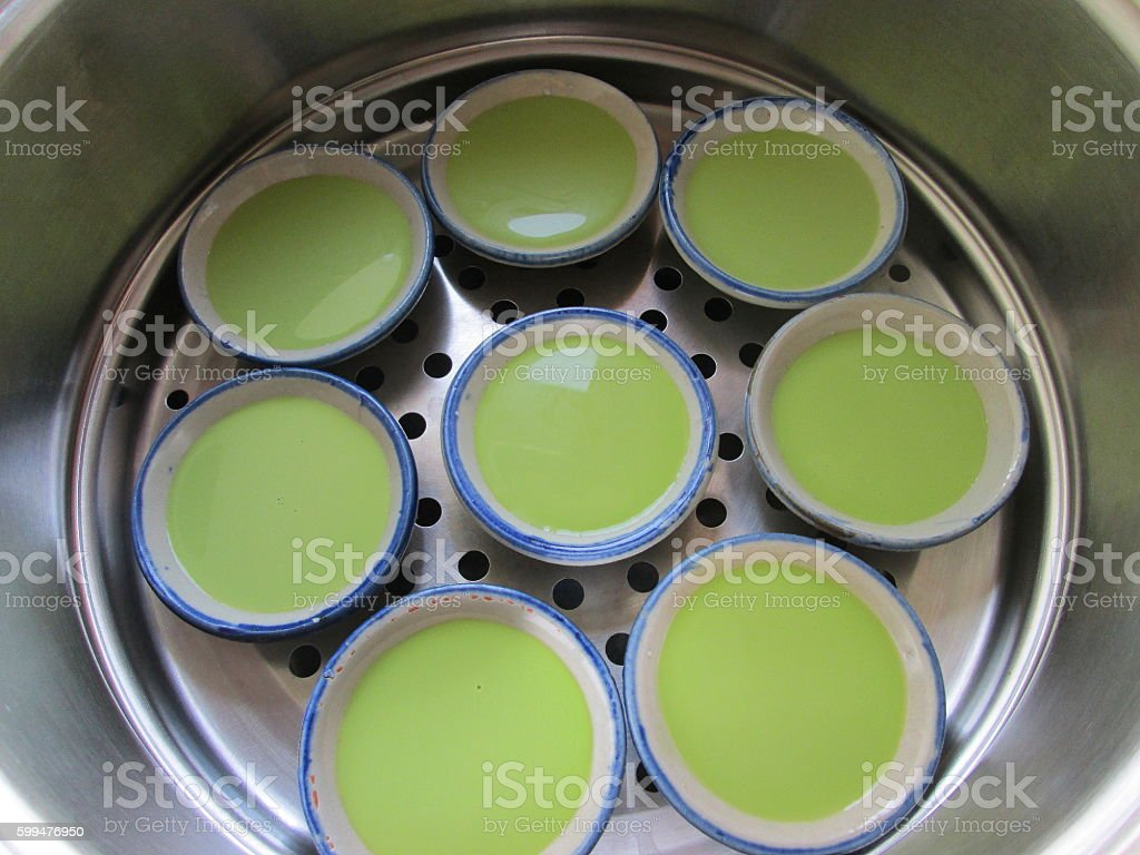 Thai coconut pudding in stainless pot, Khanom Thuay stock photo