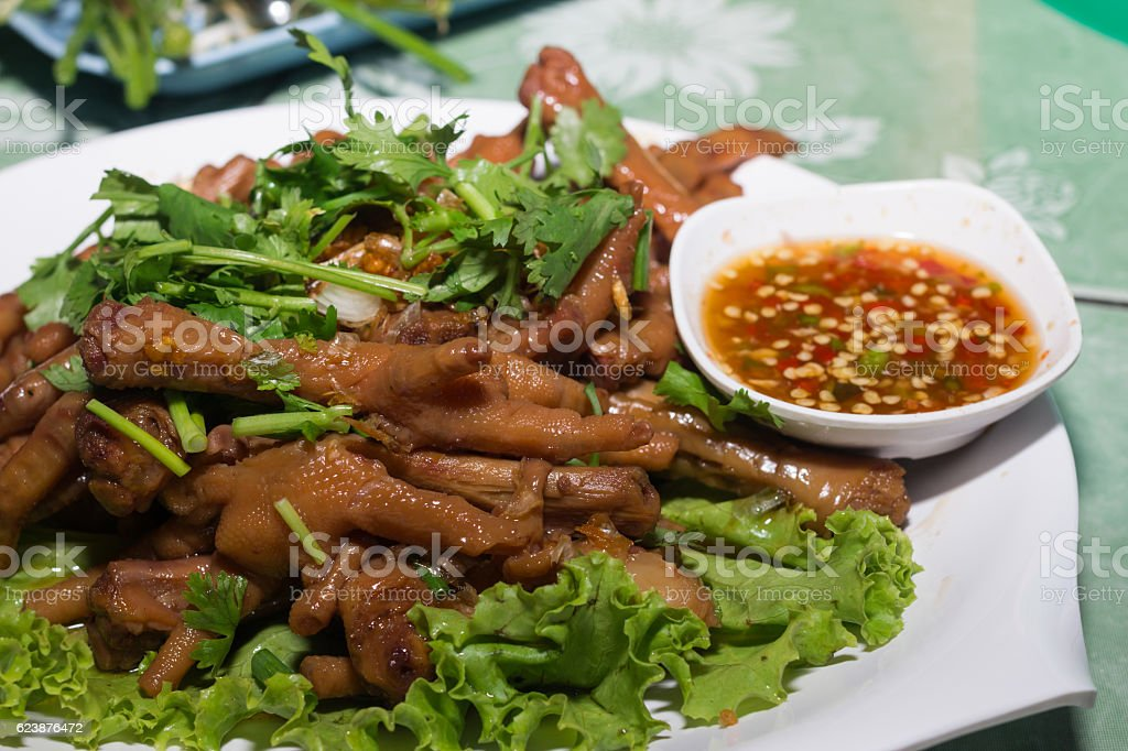 thai cooked chicken feet stock photo