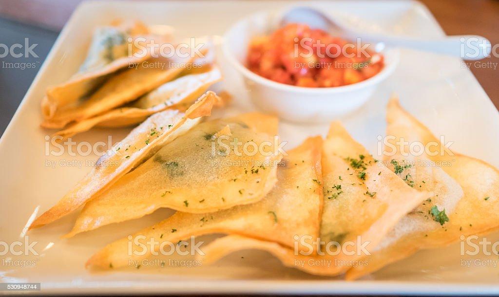 Thai crispy wonton with Salsa sauce stock photo