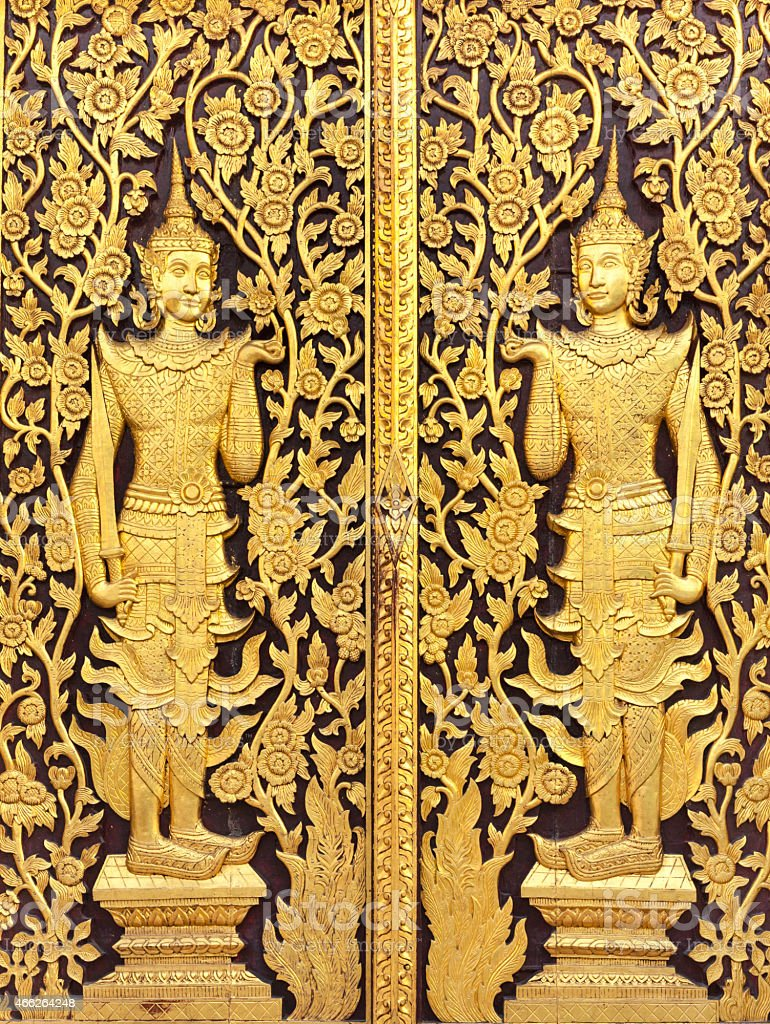 Thai culture gold sculpture on the temple wall stock photo