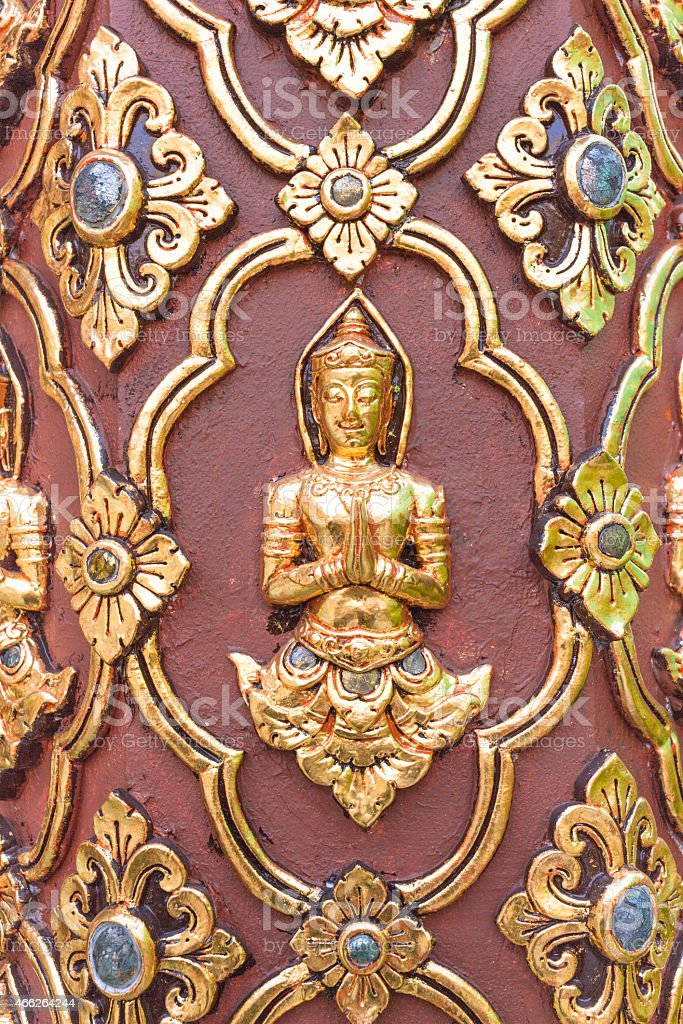 Thai culture sculpture on the temple wall stock photo