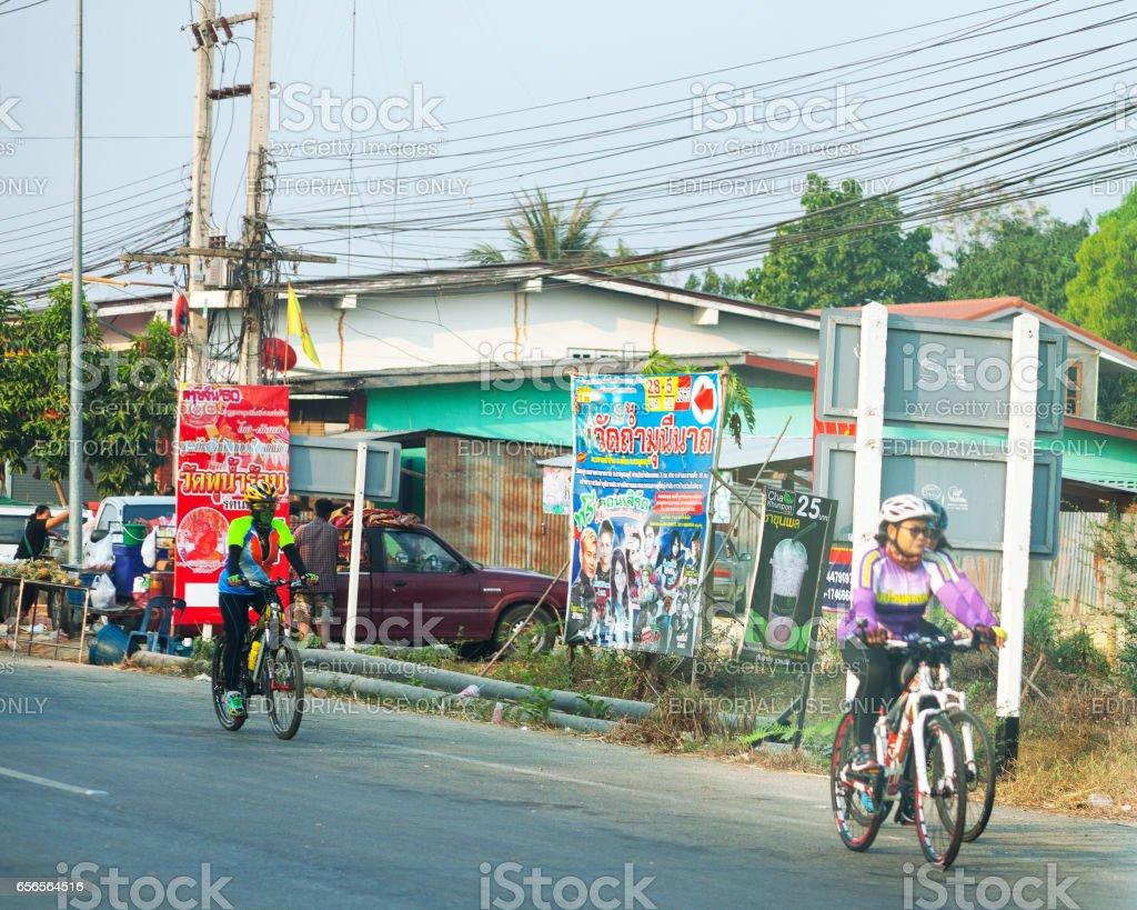 Thai cyclist on road in Kanchanaburi stock photo