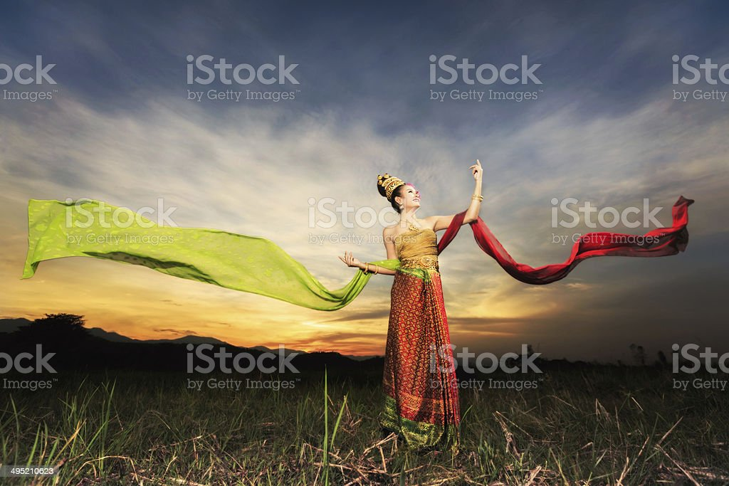 Thai dancing girl with northern style dress stock photo