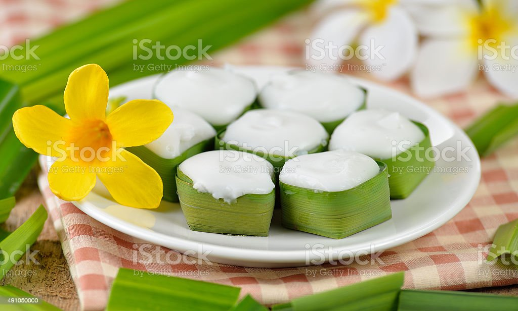 Thai dessert ,pudding with coconut topping stock photo