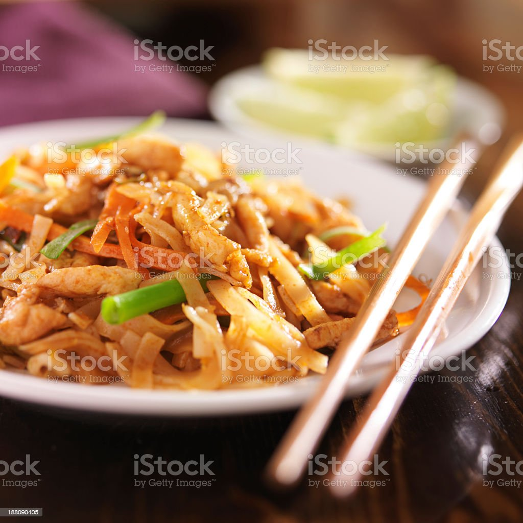 A Thai dish served in a white dish with chopsticks stock photo