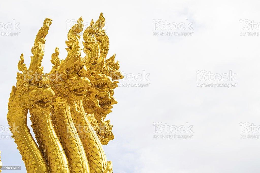 Thai dragon, golden Naga statue in temple royalty-free stock photo