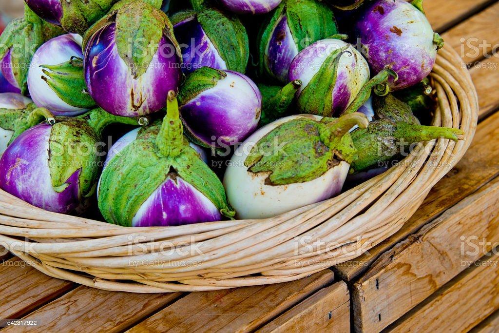 Thai Eggplant,Organic Vegetable, green, purple, Basket Rustic Crate stock photo