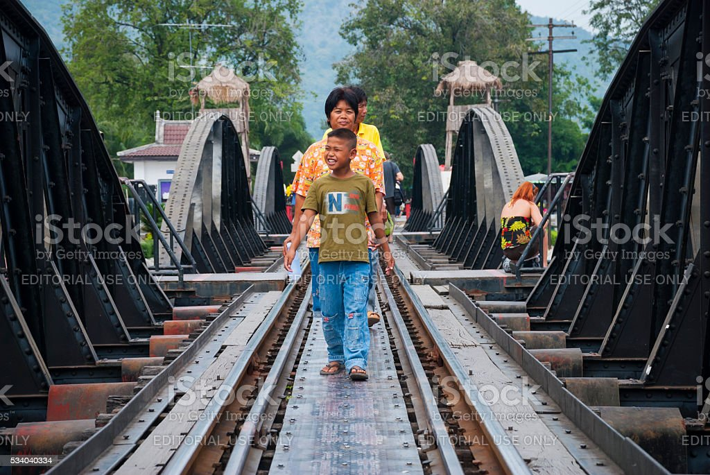 Thai family visiting the Bridge on the River Kwai stock photo