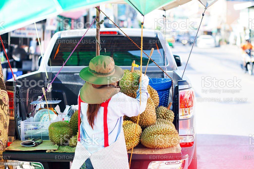 Thai farmer with Durian fruits on pick-up in Bangkok stock photo