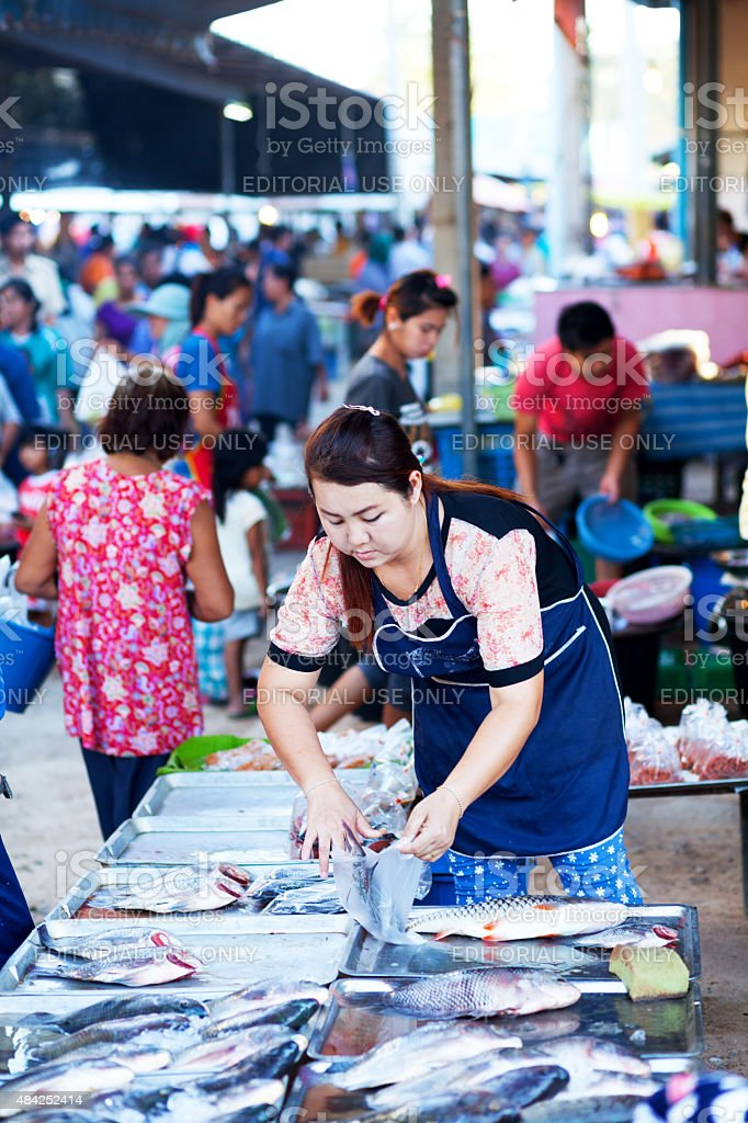 Thai female fish vendor on local market stock photo