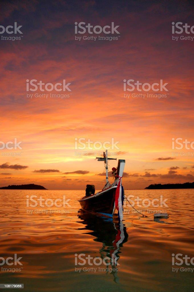 Thai Fishing Boat at Sunset stock photo