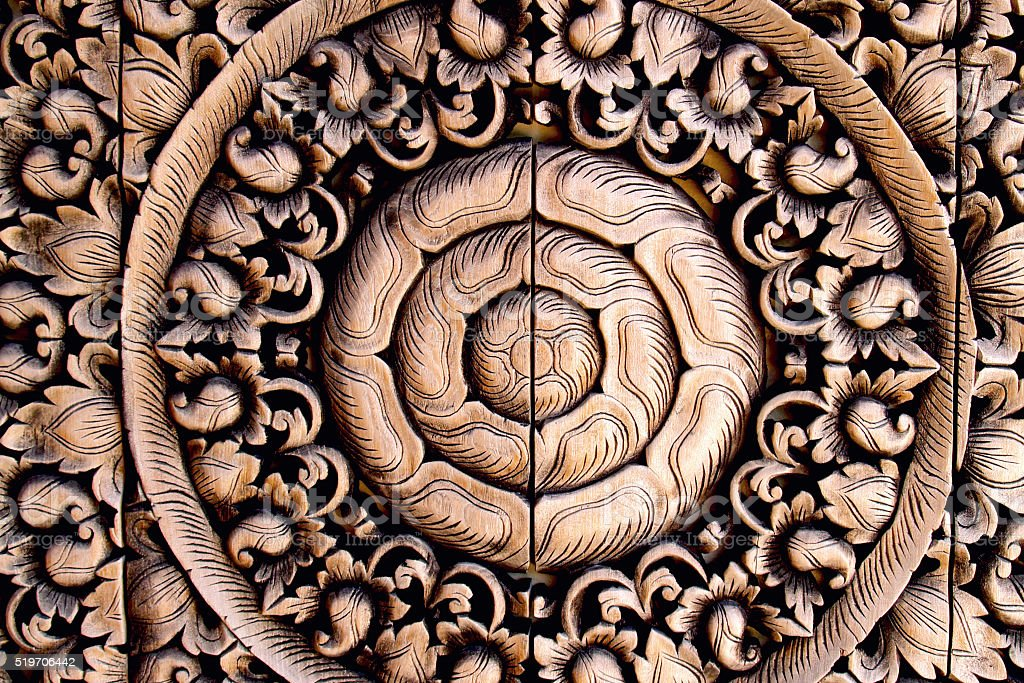 Thai flower wooden carving stock photo