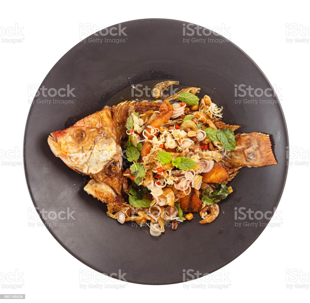 Thai food - Fried tilapia salad with lemon grass stock photo