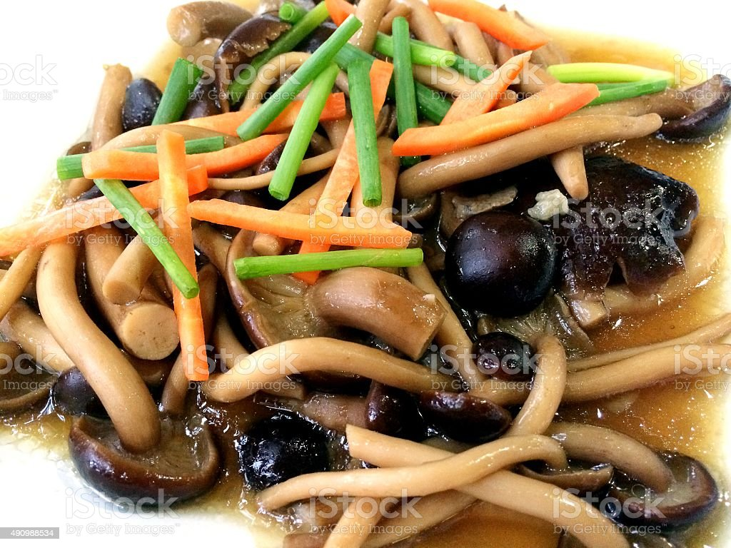 Thai food mushroom fry with oyster sauce stock photo