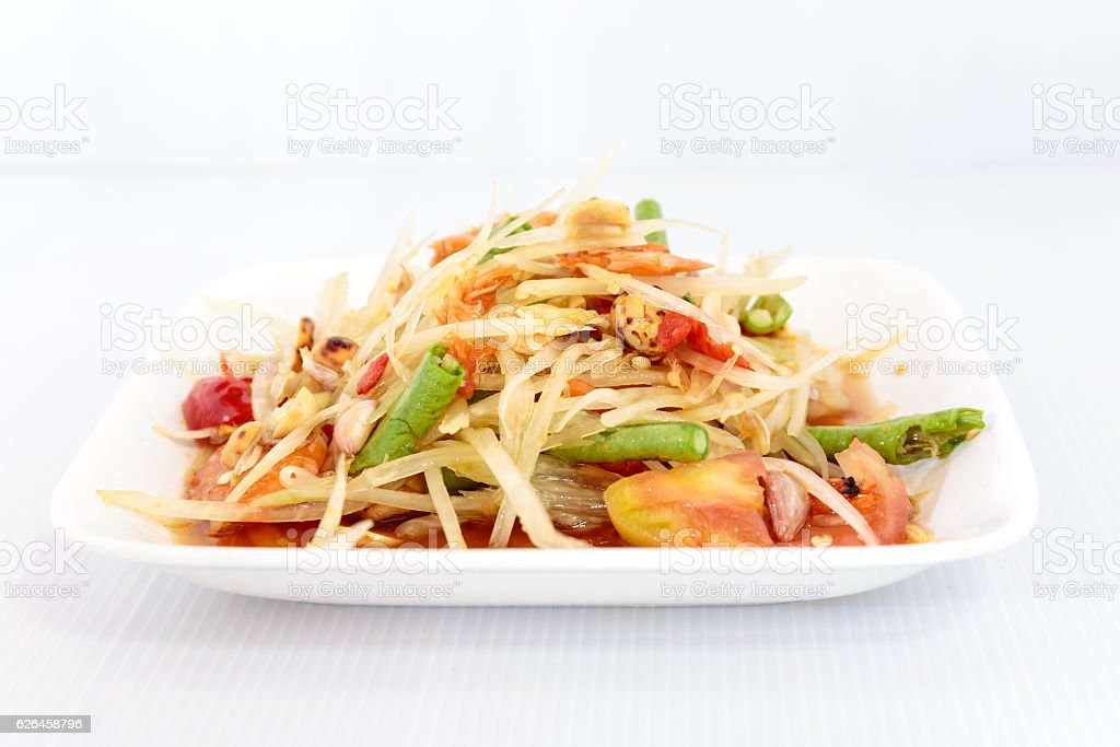 Thai food papaya salad on white dish stock photo