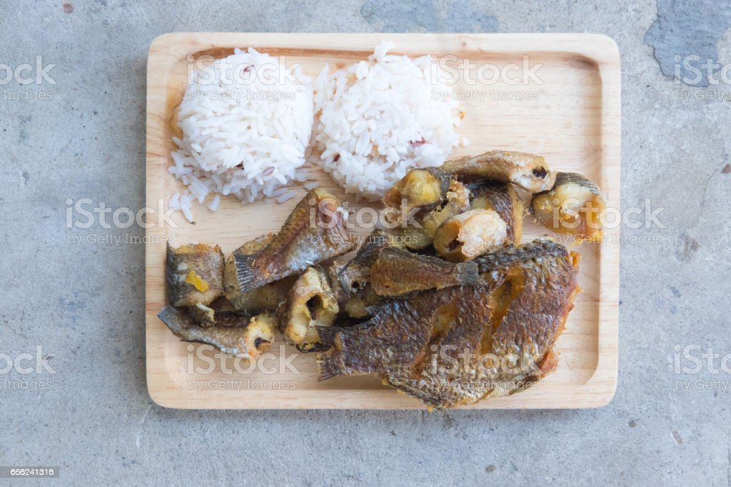 Thai food ready served Organic jasmine rice with fried of striped snakehead fish. stock photo