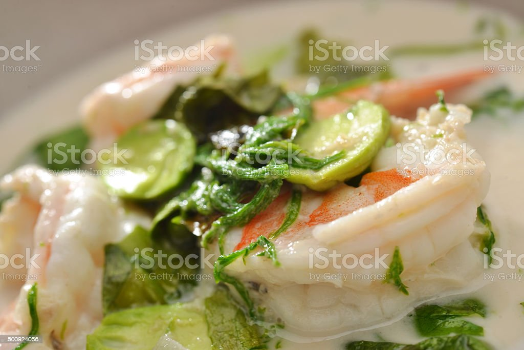 Thai food spicy shrimp and vegetable curry in coconut soup stock photo