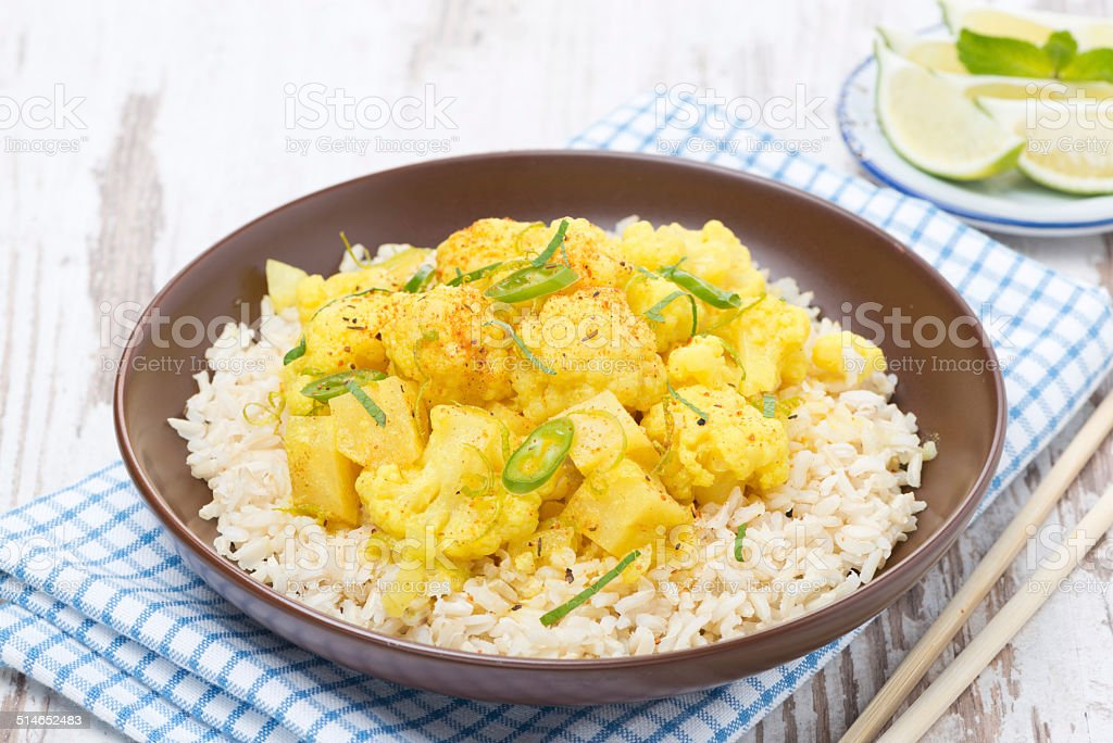 Thai food - vegetable curry with cauliflower and rice stock photo