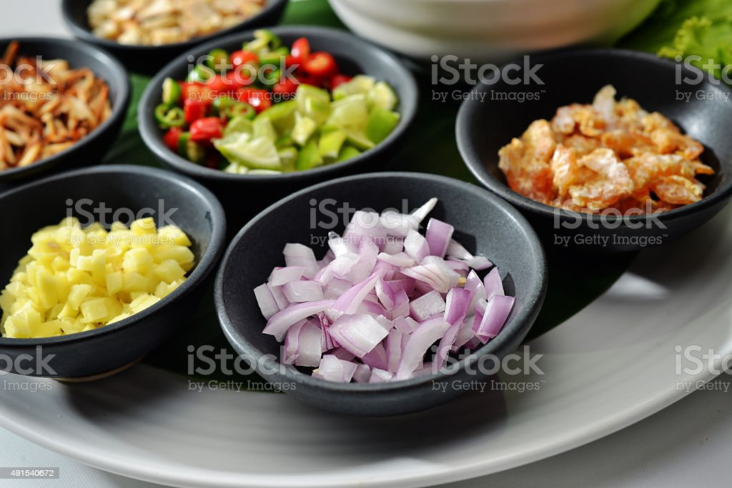 Thai Food wrapped in leaves include many spices chilli sauce stock photo