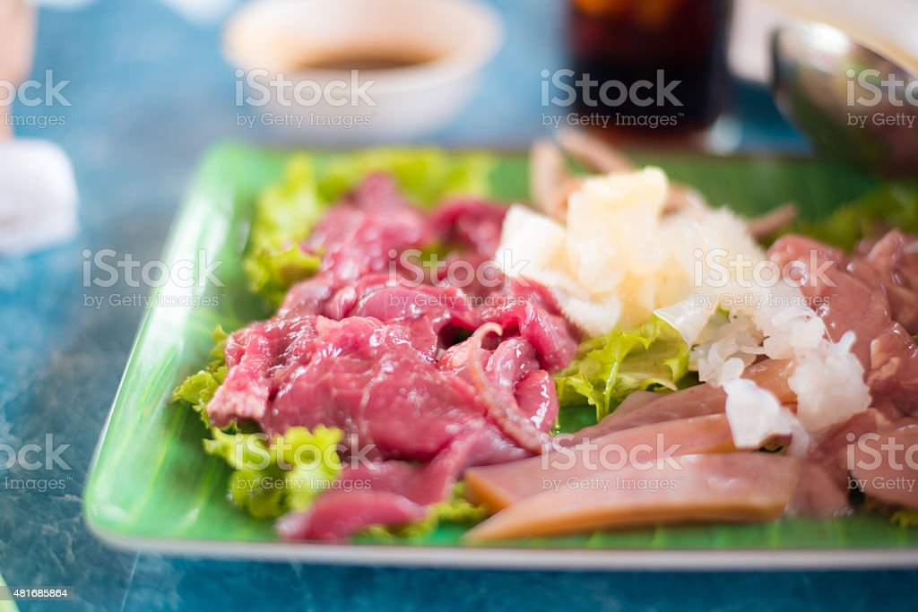 Thai food,fresh raw beef meat in restaurant. stock photo