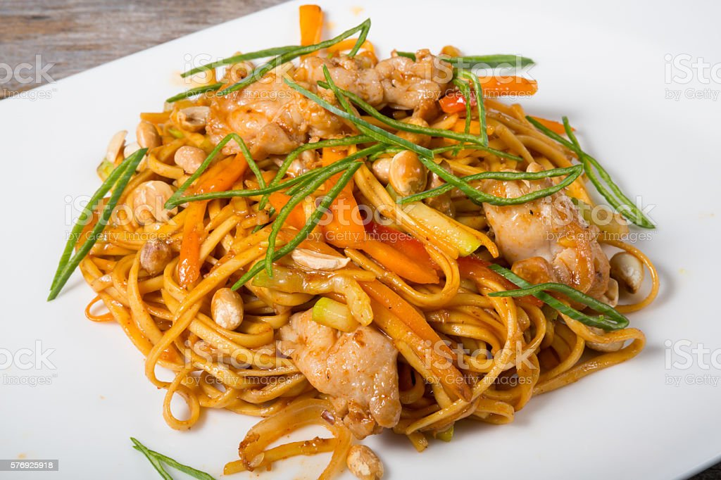 Thai fried noodles with chicken stock photo