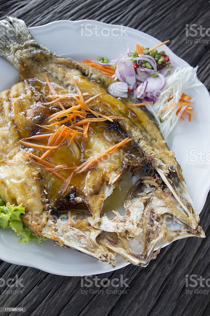 Thai fried Sea Bass with fish sauce. royalty-free stock photo