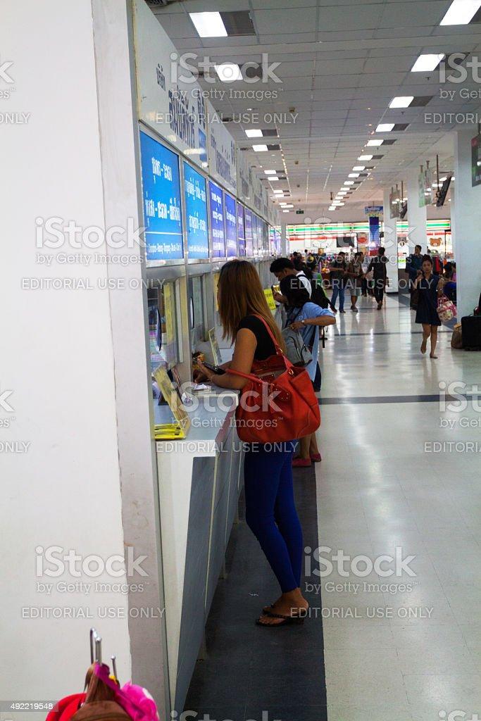 Thai girl at ticket desk in bus station Sai Tai stock photo