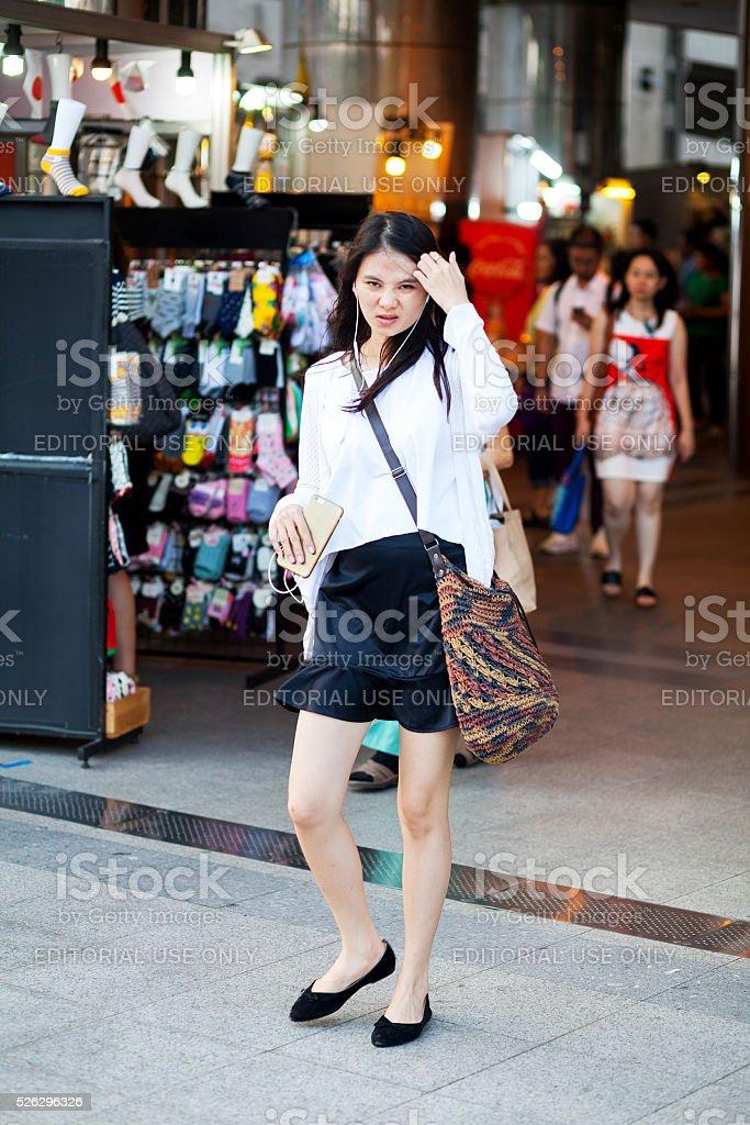 Thai girl in black skirt stock photo