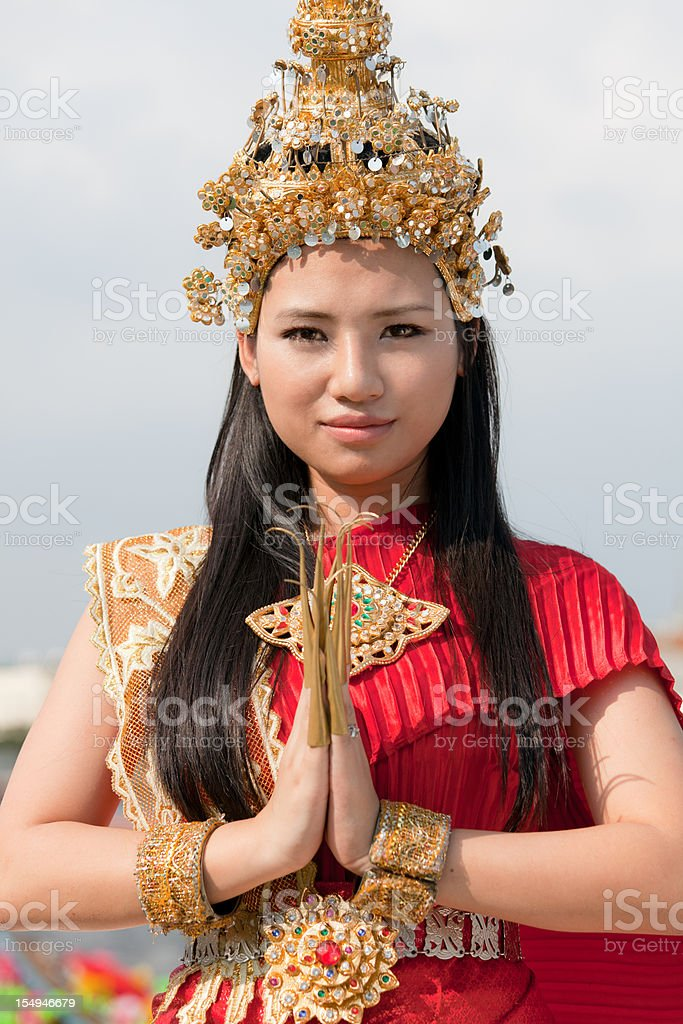 Thai girl in Traditional Dress doing a wai royalty-free stock photo