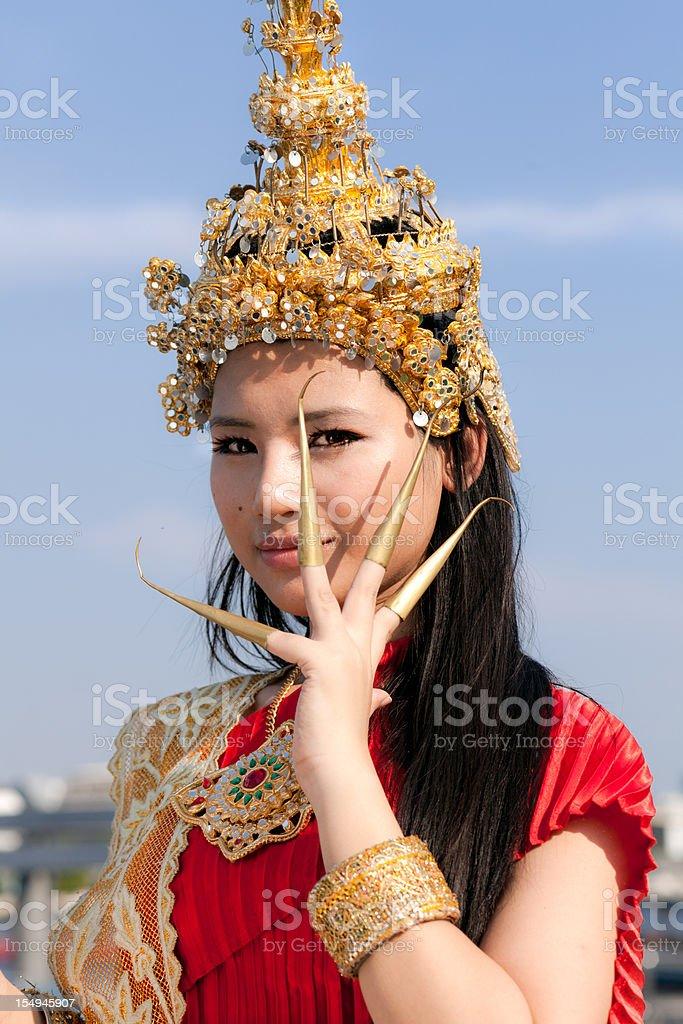 Thai girl in Traditional Dress - fingernail dancer royalty-free stock photo