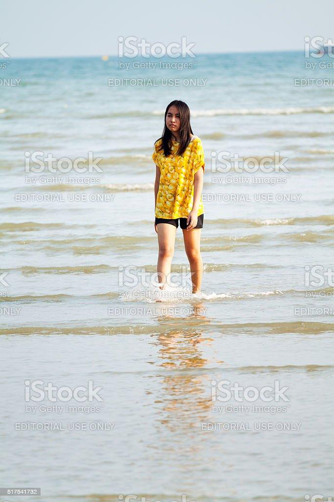 Thai girl in yellow shirt in Andaman Sea stock photo