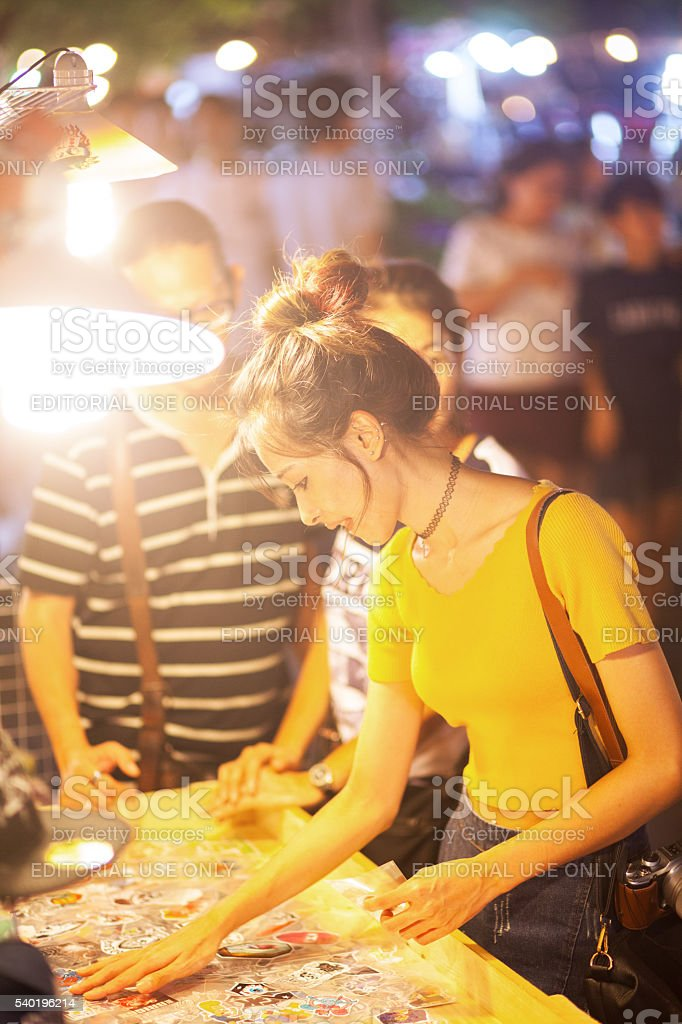 Thai girl selects stickers stock photo
