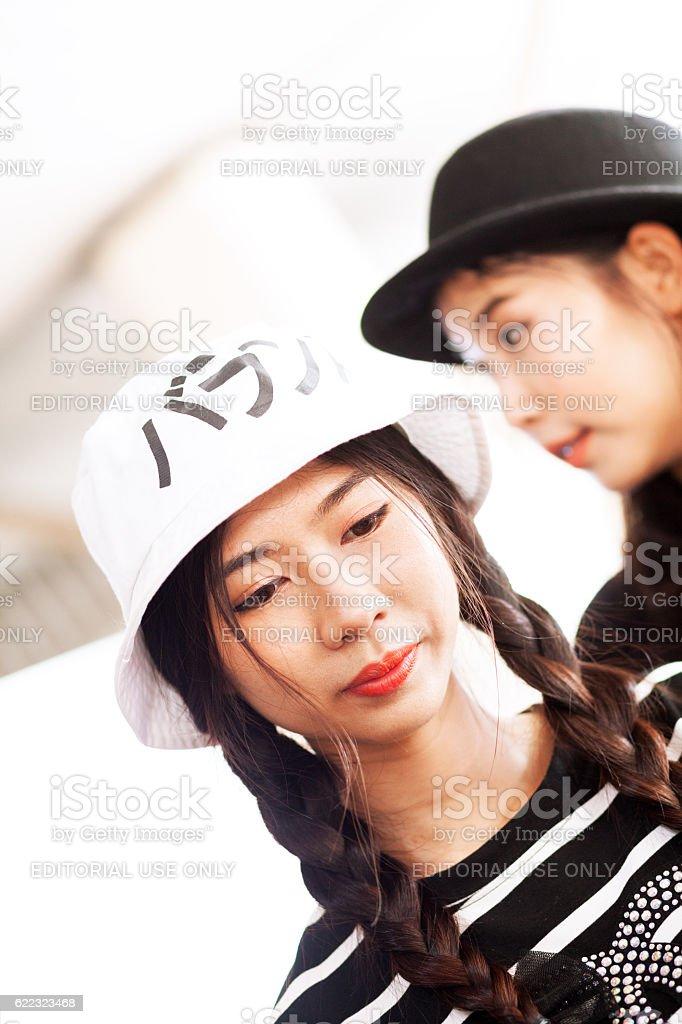 Thai girl with dark hair and braids stock photo