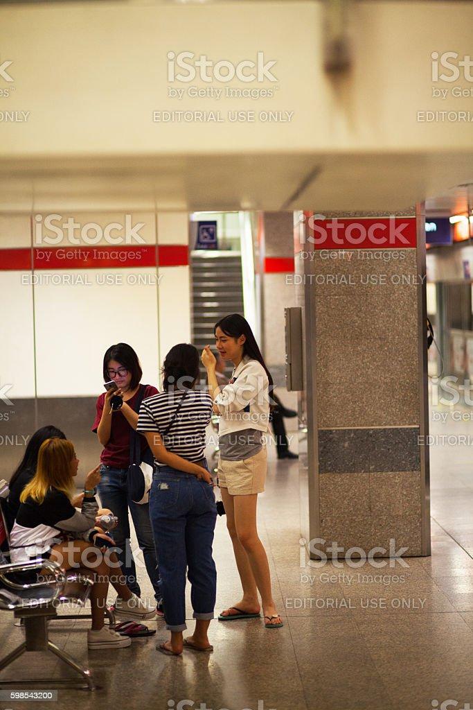 Thai girls and a transgender in MRT station stock photo