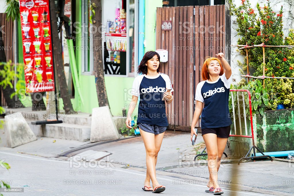 Thai girls in shirts branded with Adidas stock photo