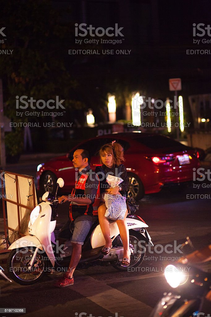 Thai girls on motorcycle taxi stock photo