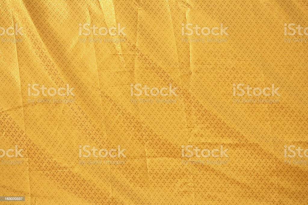 Thai Gold Colored Fabric Texture Pattern royalty-free stock photo