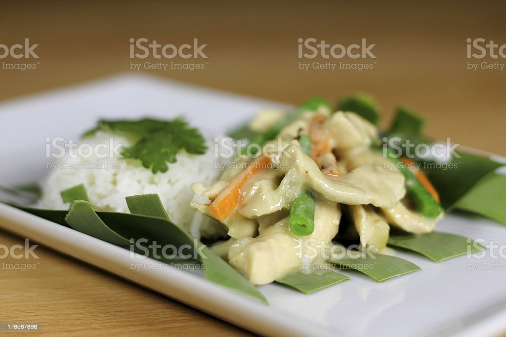Thai green chicken curry served on a weaved banana leaf royalty-free stock photo