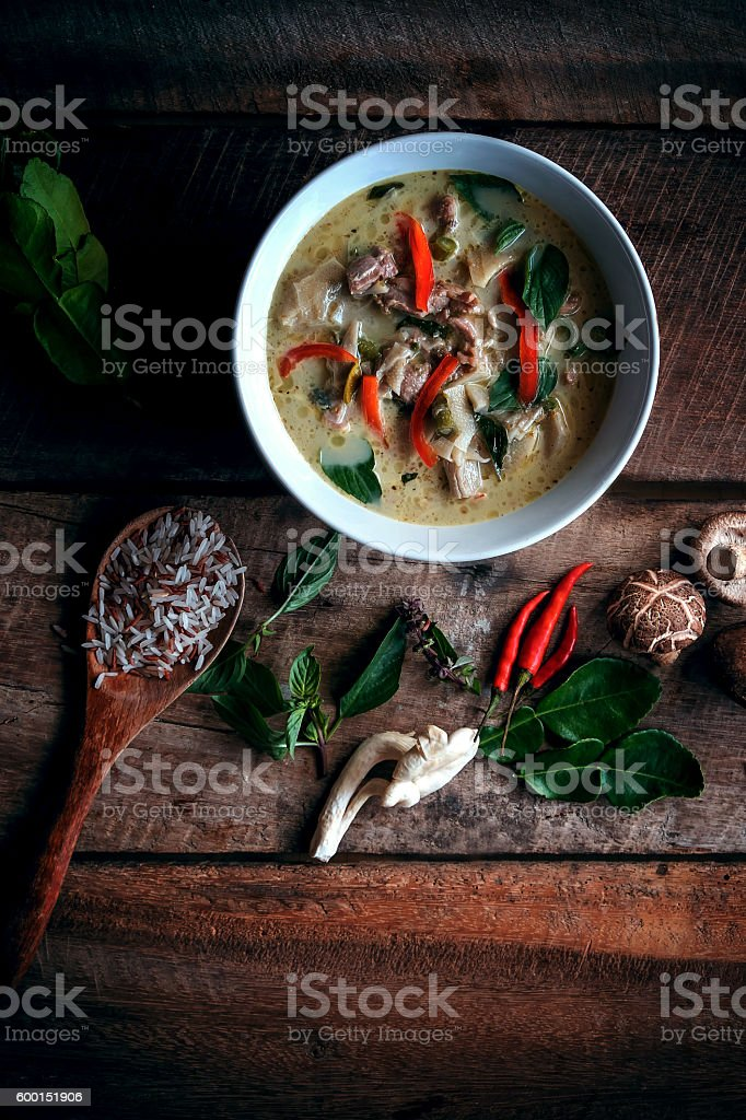 Thai Green Curry With Chicken Recipes on wooden background stock photo