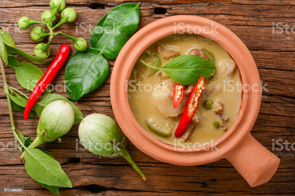 Thai Green Curry with pork in clay pot stock photo