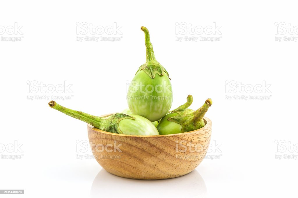 Thai green eggplant slices in the wood bowl. stock photo