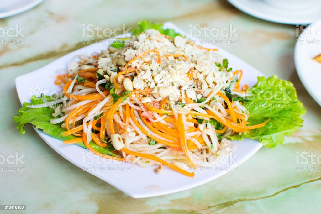 Thai green papaya salad on a plate stock photo