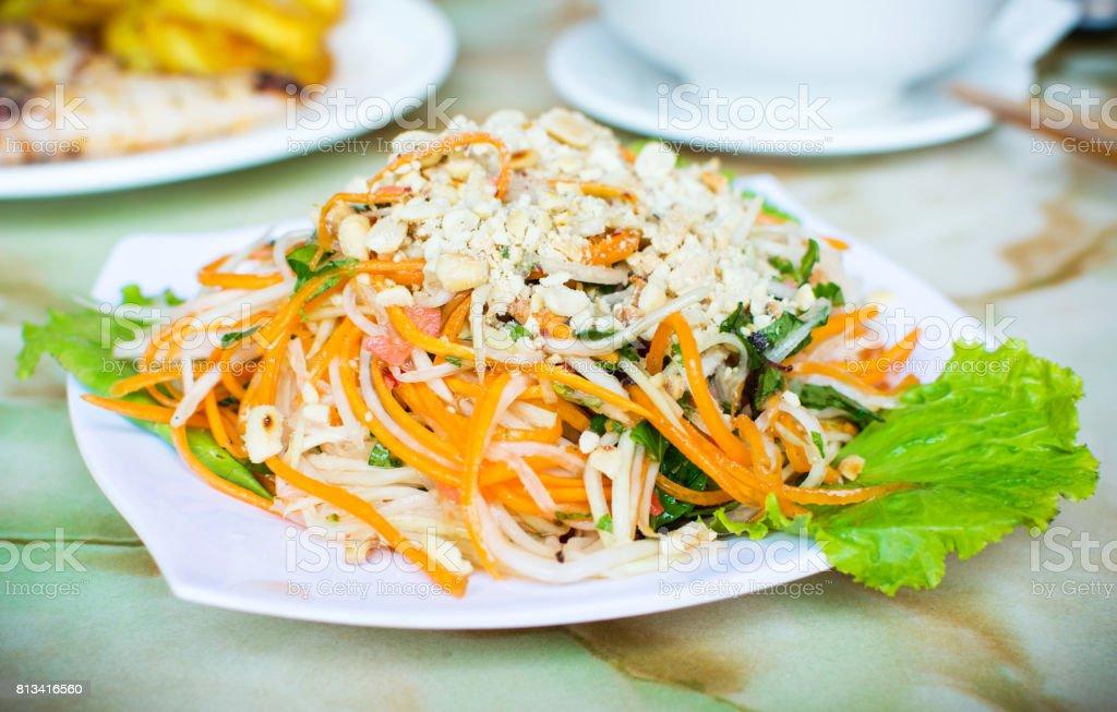 Thai green papaya salad on a plate stock photo