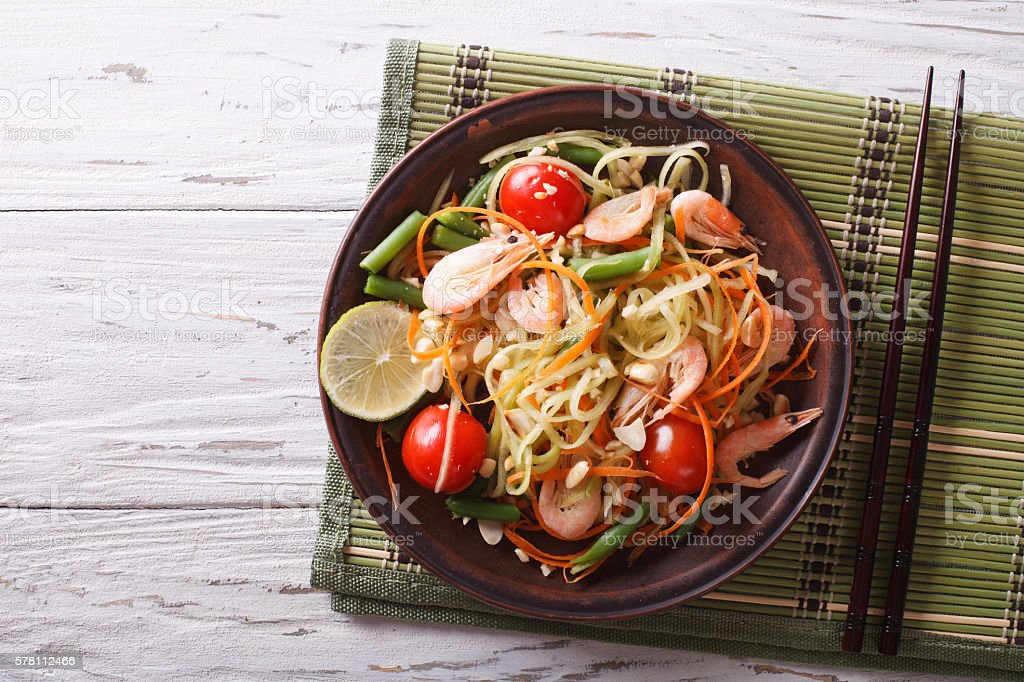 Thai green papaya salad with shrimp. horizontal top view stock photo