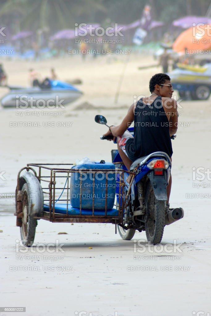 Thai guy in Patong beach stock photo