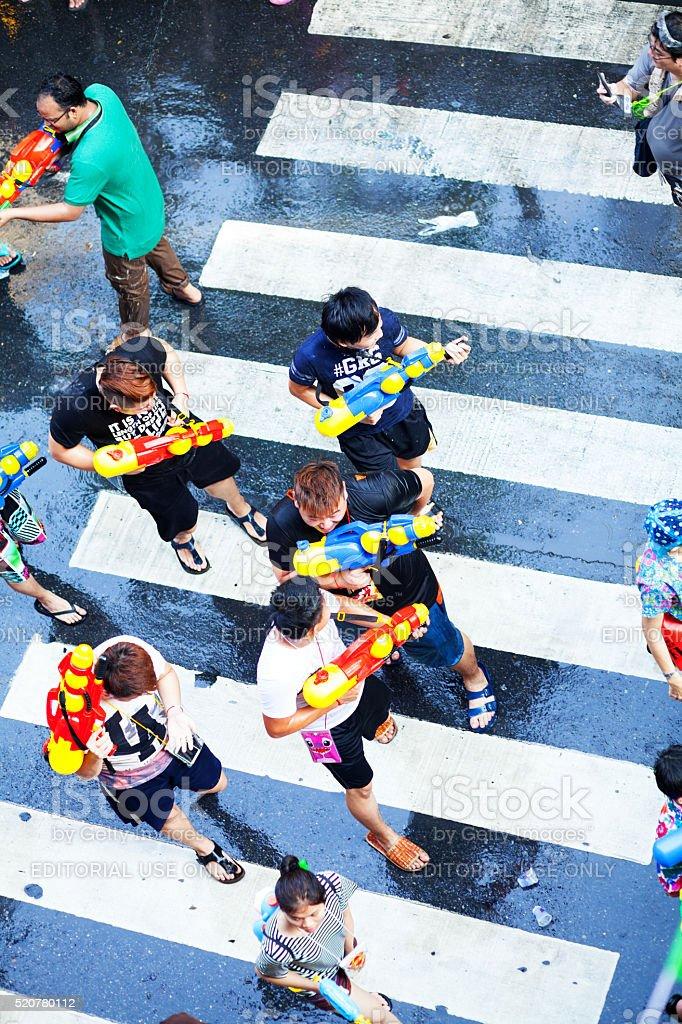 Thai guys with water guns stock photo