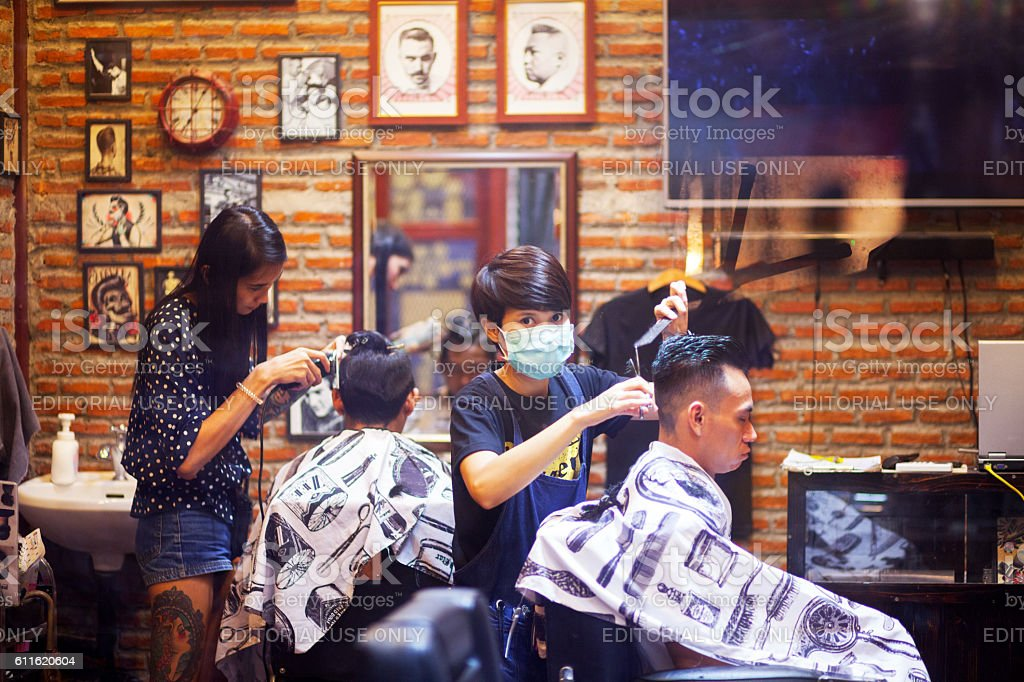 Thai hairdressers and customers stock photo