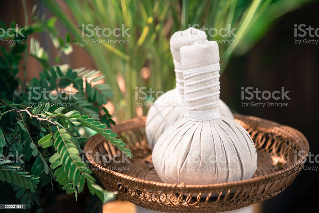 Thai Herbal Ball Hot Compress massage  add color retro style stock photo